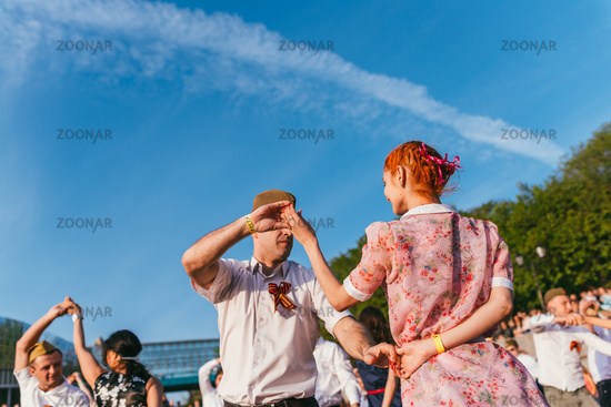 MOSCOW, RUSSIA-MAY 09, 2015: people are dancing outdoors in the Park on Pushkinskaya embankment at sunny day
