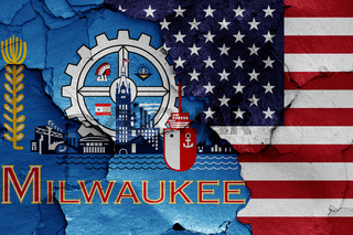 flags of Milwaukee and USA painted on cracked wall