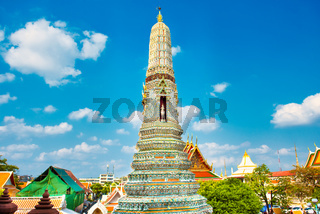 View of side tower of Wat Arun on blue sky background
