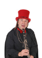 A clarinet player with a red hat and black outfit