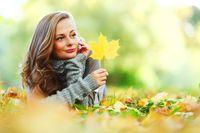woman portrait with autumn leaf