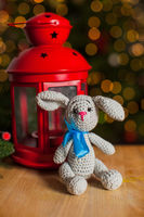 Concept of knitted the christmas rabbit toy