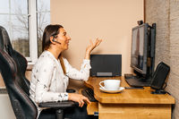 Businesswoman talking on video conference from comfort of her home during coronavirus pandemics and quarantine