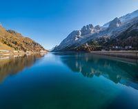 Autumn alpine Fedaia mountain Lake and Pass, Trentino, Dolomites Alps, Italy.