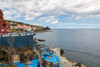Hotel with each chair at rocky coast of Madeira Island