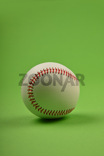 Close up one baseball ball over green