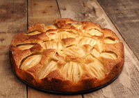 Delicious homemade organic apple pie on a rustic kitchen table