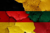 flags of Germany and Lithuania painted on cracked wall