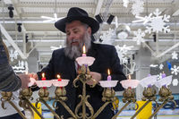 02.09.2019 Kiev, Ukraine. the chief rabbi of the city of Kiev lights candles with children at the festival of Hanukkah