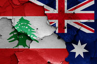 flags of Lebanon and Australia painted on cracked wall