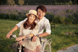 The young couple riding a bicycle