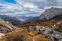 Overcast morning autumn alpine Dolomites mountain scene. Peaceful Valparola Pass view, Belluno, Italy.
