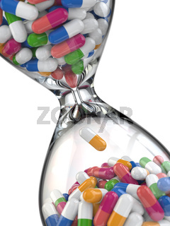 Time of medicine. Pills in hourglass