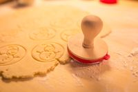 Christmas cookies bakery with raw biscuit dough and cutters with christmas theme shape - Christmas theme dough stamp, Snowman.