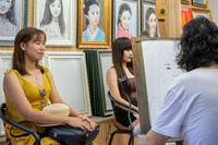 Artist drawing portraits of chinese woman