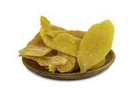 Pile of dehydrated mango in a wooden plate on white background
