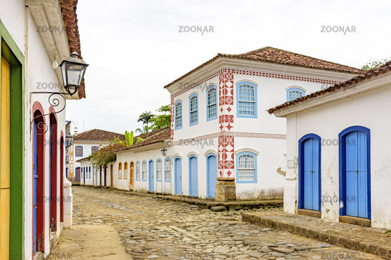 Streets with cobblestone pavement with old houses in colonial style in the city of Paraty