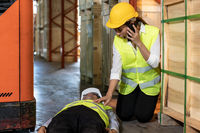 Warehouse worker call ambulance after accident