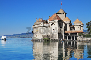 The white  motor ship floats by a castle