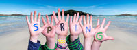 Children Hands Building Word Spring, Ocean Background