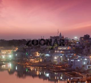 Sacred Puskhar lake (Sagar) and ghats of  town Pushkar in twilight in the evening