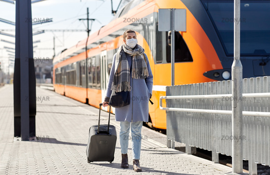woman in protective face mask at railway station