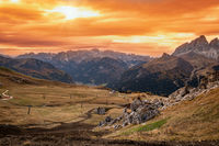 Autumn alpine Dolomites mountain dramatic sunset scene near Pordoi Pass, Trentino , Italy.