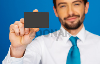 Businessman holding blank businesscard