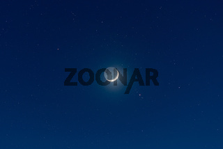 Waxing crescent moon and starry sky
