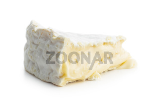 Brie cheese. White soft cheese with white mould.