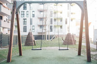 Swing set in a backyard. Childhood and youth memories concept.