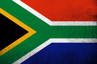 the South Africa National flag. Grunge background