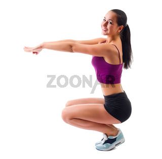 Young sporty woman doing gymnastic exercises isolated