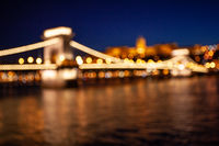 Blurred chain bridge in Budapest at night. Hungarian landmarks