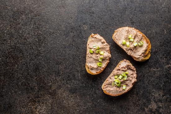 Liver pate on sliced baguette.