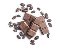 Milk chocolate bars and cocoa beans