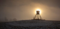 Lookout tower for hunting on the hill at sunrise.