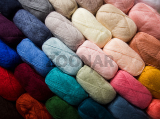 The cotton threads for yarn of different colors as a background