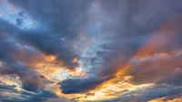 Sky with clouds of different colours at sunset