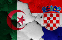 flags of Algeria and Croatia painted on cracked wall
