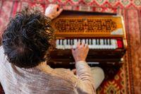 Man playing soulful music with harmonium