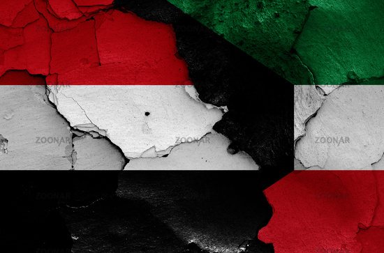 flags of Yemen and Kuwait painted on cracked wall
