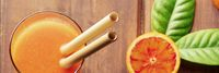 Reusable bamboo straw panorama on a rustic wooden background, fresh orange juice with blood oranges, shot from above, selective focus