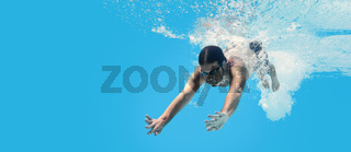 Man swimming in the blue clean water. Background with copy space. Under water training and social distance concept.