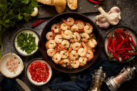 Tasty shrimp tails fried in butter with, garlic, parsley, white wine chili. With various ingredients