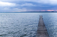 Pier at a lake by almost night