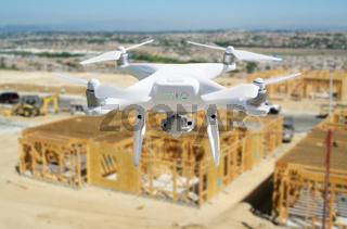 Unmanned Aircraft Quadcopter Drone Flying and Inspecting Construction Site