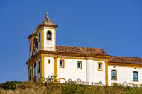 Side view of old and historic church in 18th century colonial architecture at Ouro Preto city
