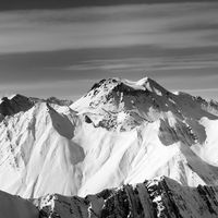 Black and white view on snowy high mountains in winter