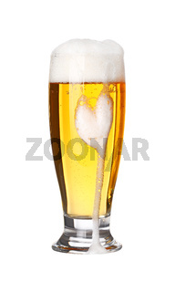 Close up one frothy beer glass isolated on white
